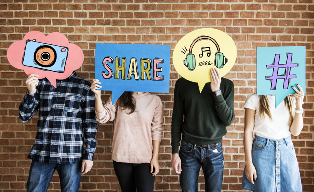 friends holding up thought bubbles with social media concept icons 53876 85495